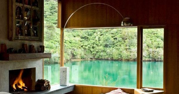 New Zealand lake house. Love the view and the funny furniture.