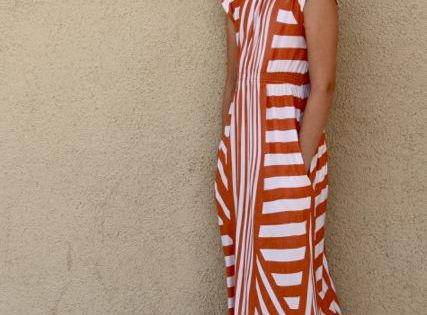 I love the use of the striped fabric on this dress. I