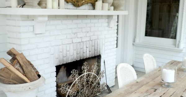 Cozy Vintage Style Dining Room White Brick Fireplace Urn