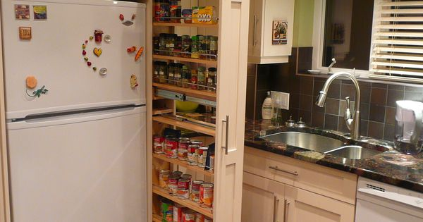 The Narrow Cabinet Beside The Fridge Pulls Out To Reveal A Spice Canned Goods Pantry Pantry