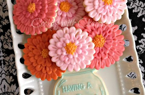 Beautiful zinnia flower cookies, perfectly arranged with a mason jar cookie!