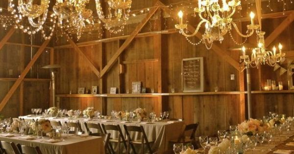 Oh how a chandelier can change the entire look of a barn!