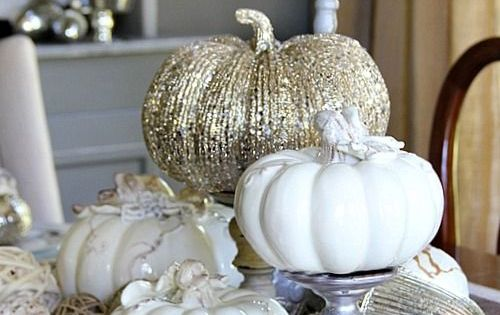 Elegant white and gold pumpkins as centerpieces for a more sophisticated fall