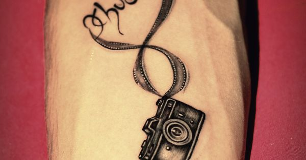 Beautiful Small Camera And Infinity Love's Name Concept