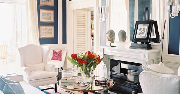 Navy walls, white trim, white furniture