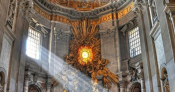 God's beam of light in St. Peter's Basilica - Rome, Italy. It