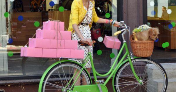 polka dot dress, pink boxes and green bike