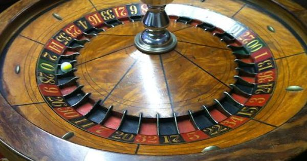 Roulette wheel cigarette dispenser