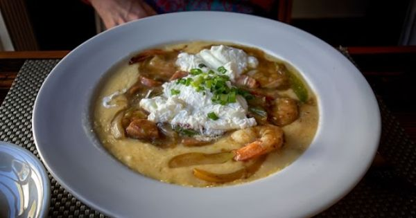This Ain T Your Mama S Shrimp N Grits Poogin S Porch In Charleston Sc Eat Charleston Restaurants Food