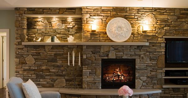 Asymetrical fireplace with TV that is NOT modern. Yeah! Like this. stone