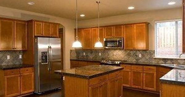 Honey Oak Cabinets With Stainless Steel Appliances Google Search Cherry Wood Cabinets Wood Kitchen Cabinets Oak Kitchen Cabinets