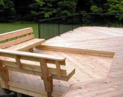 This cedar deck features a lower level allowing a seperate for Cedar decks pros and cons