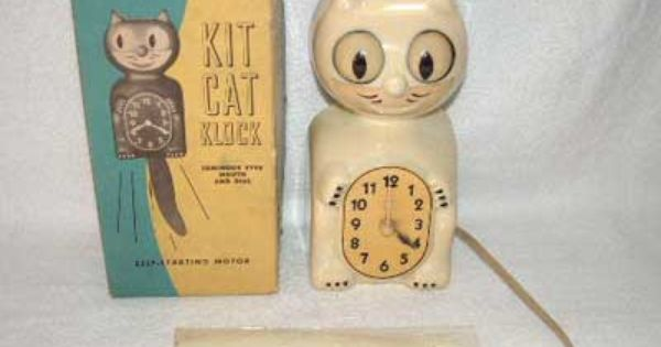 Ivory Glow In The Dark Kit Kat Clock