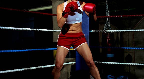 Young Female Boxer In Ring Gloves Raised Portrait Boxing