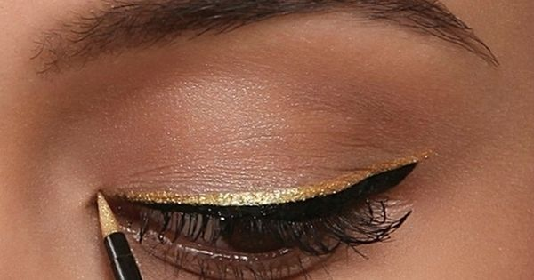 gold liner over black liner. Maybe it's The Hunger Games premiere talking,