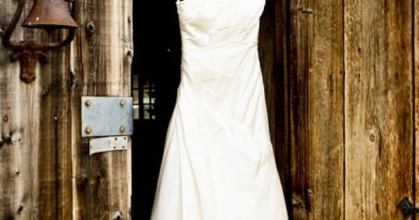 Rustic door with wedding dress. Beautiful dress!!
