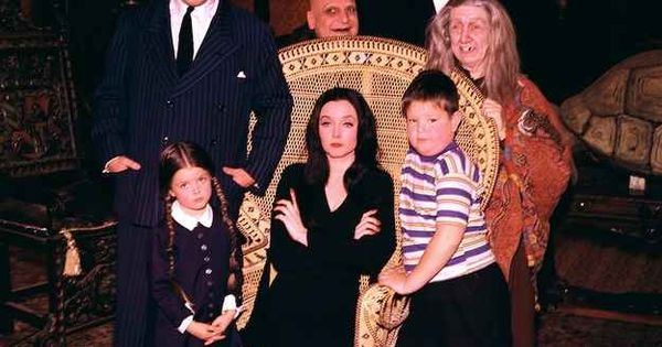 These color photos of the original addams family cast for The addams family living room