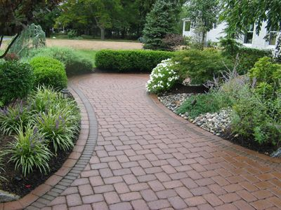 Front walk paver ideas of a paver walkway should for Landscaping rocks daytona beach