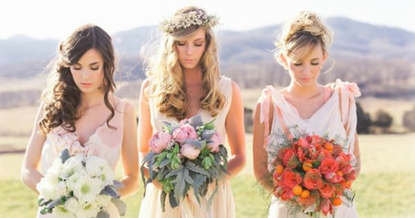 We love that each of these bridesmaids is carrying a bouquet of different flowers!
