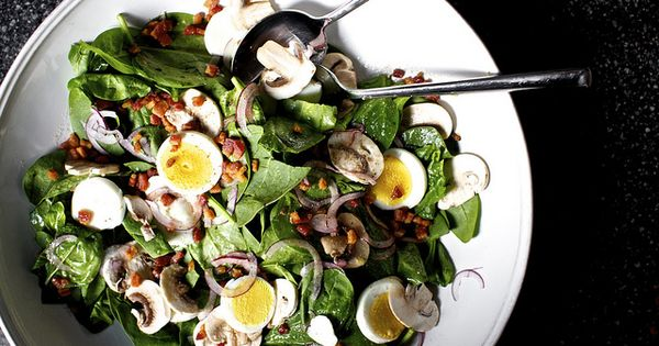 A classic steakhouse spinach salad with warm bacon vinaigrette marries healthy greens