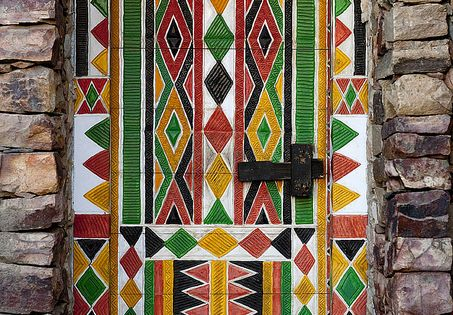 Burkina Faso. The colors are vibrant, the shapes timeless, and the door,