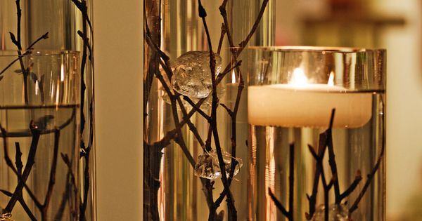 Dollar store vases, branches, water, and floating candles. great idea for our