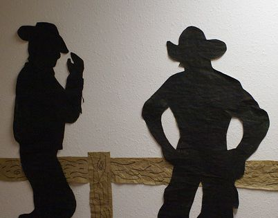 cowboys silhouettes - by covered wagon & gateway into foyer