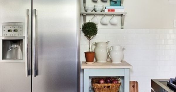 Small kitchen storage put baskets above the cabinets for Extra storage for small kitchen