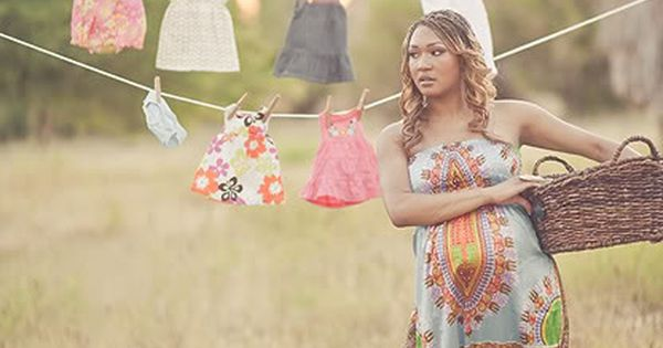 Maternity Photo Shoot: I love the baby clothes in the background! This