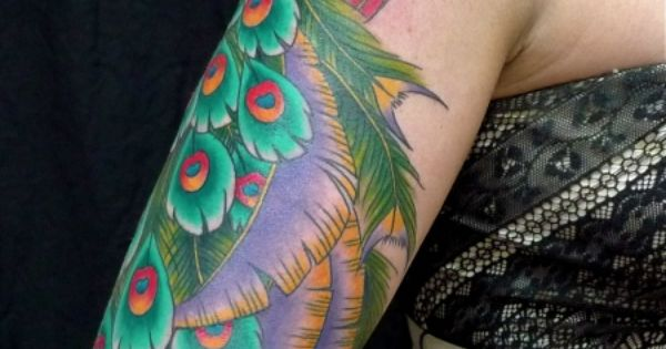 Peacock tattoos are beautiful. I love this sleeve.
