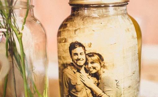 laminate sepia pictures and put in mason jars of water. cute idea