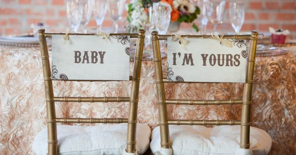 """Baby I'm Yours"" chair decor for the bride and groom"