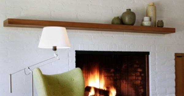 how perfect. a white brick fireplace and mid century style