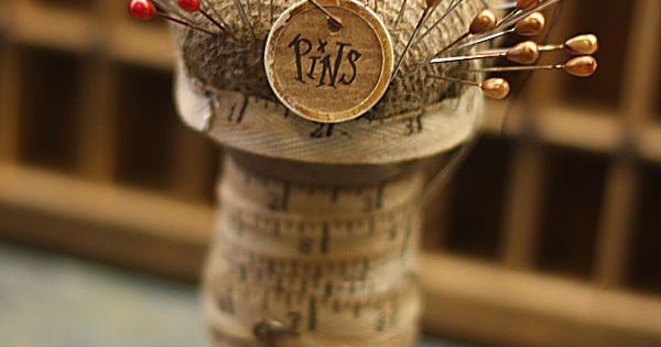Pin cushion made from an old thread spool and measuring tape...