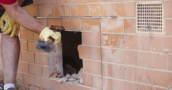 Man Knocking Bricks Out Of Wall With Mash Hammer Brick Wall Brick Patio Wall
