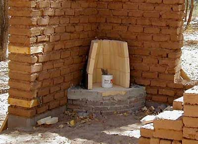 Starting To Build The Kiva Fireplace Outdoor Fireplace Designs Outdoor Fireplace Earthship Home