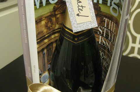Engagement Gift for the bride-to-be: A bottle of champagne wrapped up in