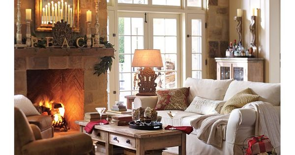 Living room idea for placement of furniture around fire place and is