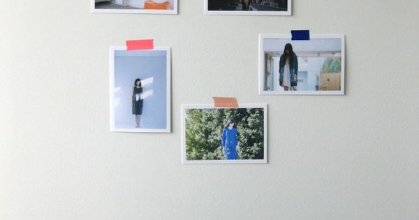 Sweet simple decorating idea: post photos on the wall with washi tape.