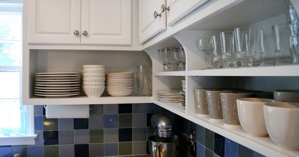 Raise your kitchen cabinets and add shelving underneath