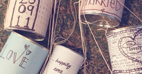 How cute! The traditional cans that trail the getaway car - adorable idea for a vintage wedding! I love the details that were put on them! Vintage Wedding Vintage Wedding Ideas wedding dress