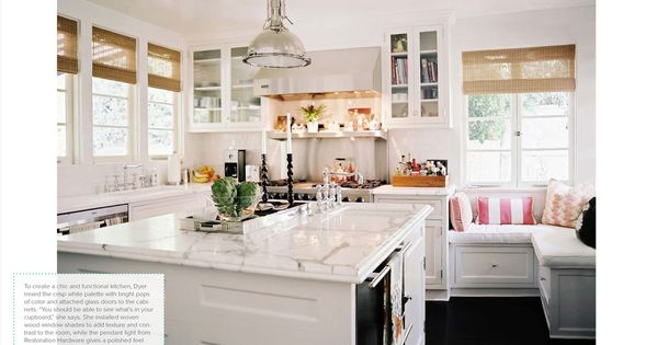 Cozy and clean bright white kitchen. Love the marble and window bench