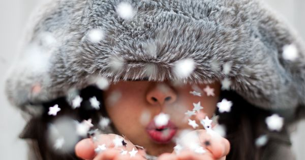 Kid blowing paper stars - good idea for Christmas card