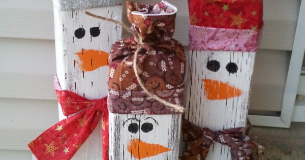 Wooden snowmen for the front porch