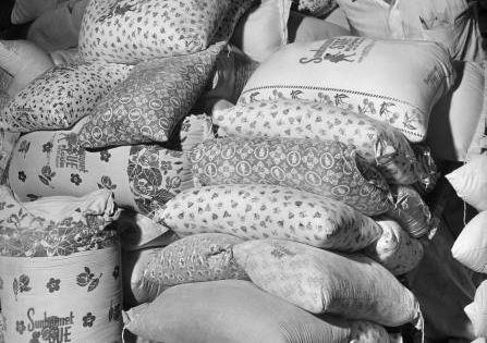 1939 Kansas Wheat Warehouse worker wheeling colorfully ...