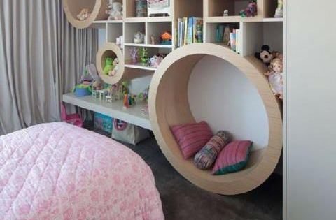 Storage walls with reading nook. Awesome for kids room