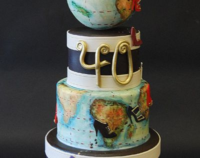 globe travel cake. This company makes amazing cakes. They have a map/luggage