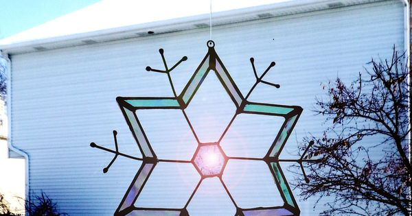 small stained glass ornament transforms the view of the house next ...