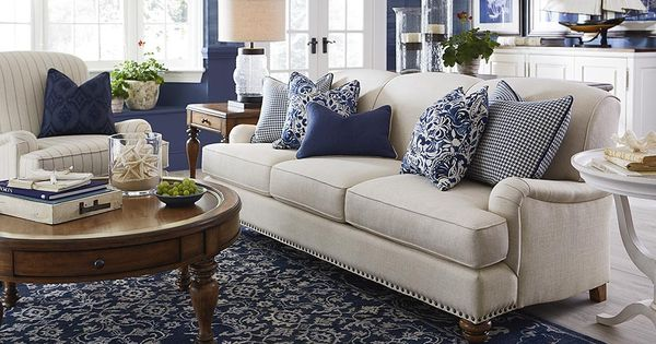Taupe Sofa With Navy Ivory Rug Living Room Theme