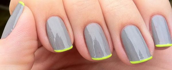 A pop of neon brightens monochromatic nails. | 25 Eye-Catching Minimalist Nail